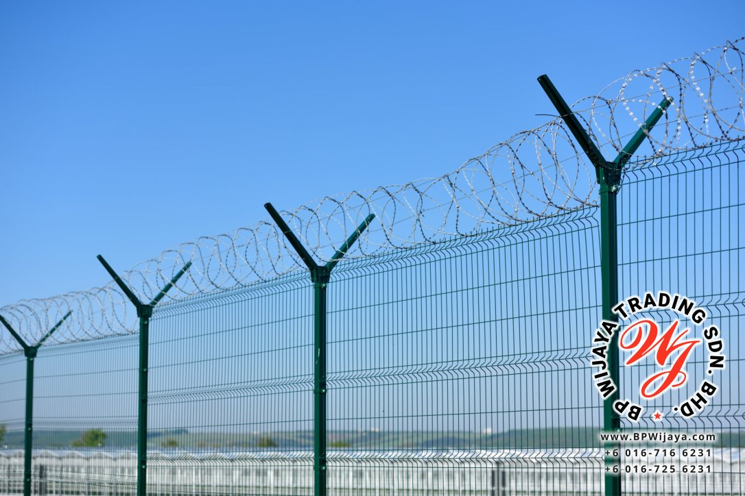 The barbed wire fence