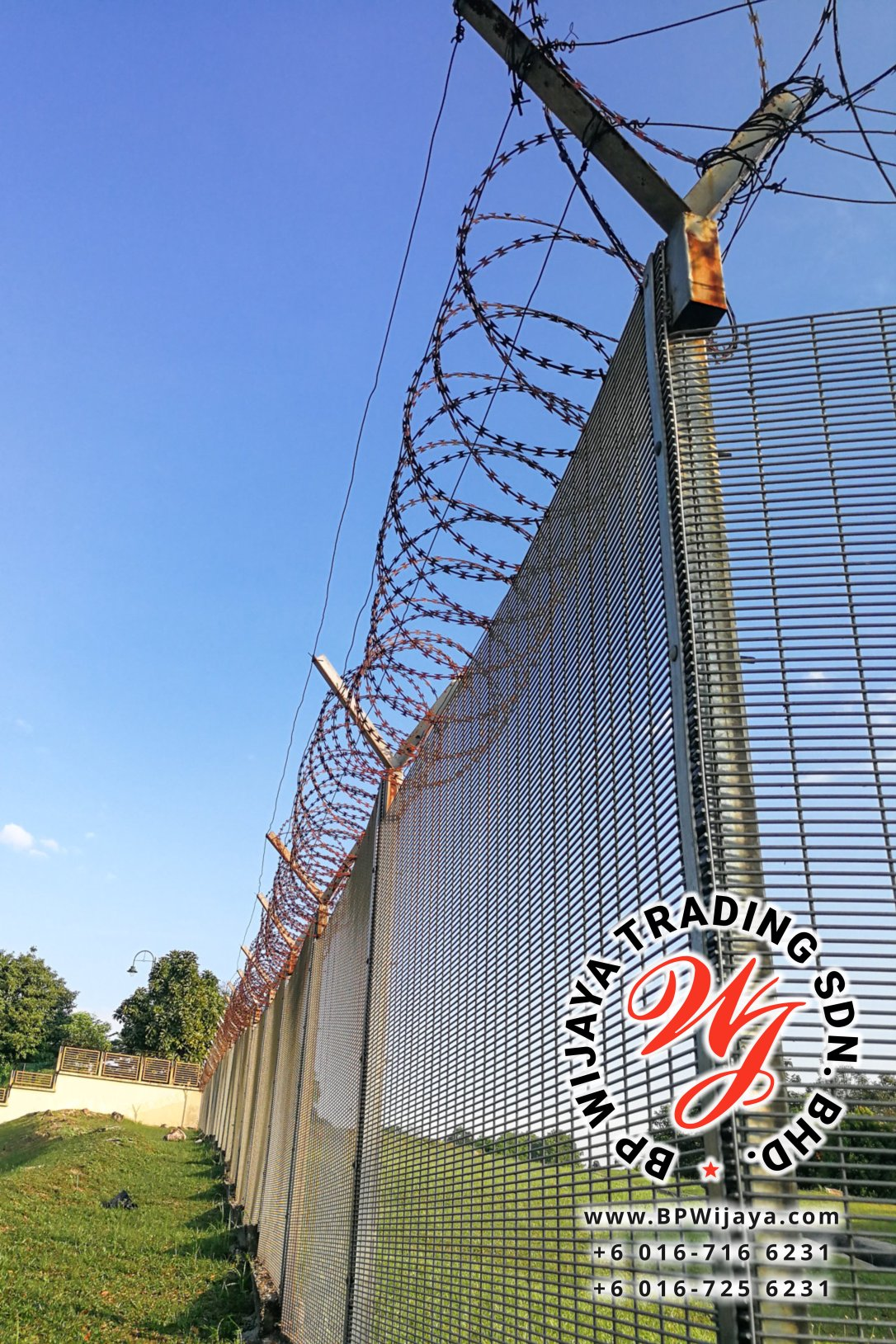 Sharp barbed wire on security fence protecti secure private spac